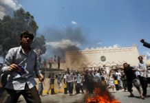 Protesters gather outside the U.S. embassy in Sanaa.