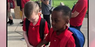 Second-grade student helps classmate with autism