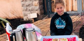 Katelynn Hardee selling cocoa, cider and cookies.