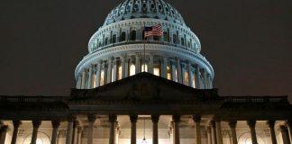 Lights shine on the U.S. Capitol dome, Monday, Dec. 9, 2019