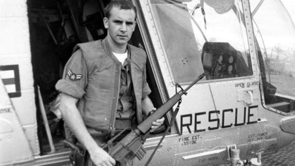 A1C William Pitsenbarger with an M-16 outside the HH-43. circa 1965 (Photo: National Museum of the U.S. Air Force)
