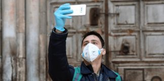 Man Takes Selfie at Church of the Holy Sepulchre in Jerusalem.