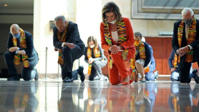 Nancy Pelosi wearing her Kente Scarf