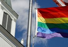 Gay pride rainbow flag outside Asbury United Methodist Church