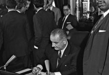 Signing the voters Rights Act