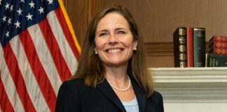 Supreme Court nominee Judge Amy Coney Barrett smiles during a meeting with Sen. David Purdue, R-Ga., on Capitol Hill,