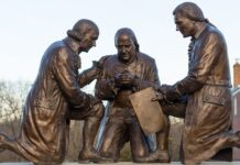 This statue by Stan Watts depicts Founding Fathers John Adams, Benjamin Franklin and Thomas Jefferson kneeling in prayer.