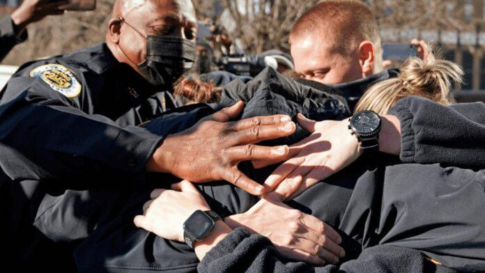 Nashville police officers embrace