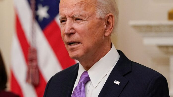Biden speaks about coronavirus in the State Dinning Room of the White House