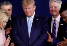 Pastor Paula White, left, and other faith leaders pray with President Donald Trump