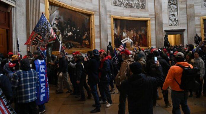 Supporters of President Donald Trump enter the U.S. Capitol's Rotunda in Washington on Jan. 6, 2021.