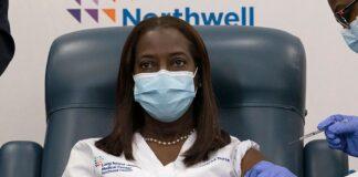 Nurse getting COVID-19 Vaccine