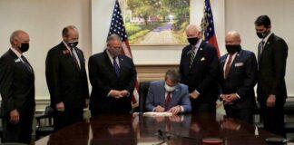 Brian Kemp signs Georgia's SB 202 Election Integrity Act