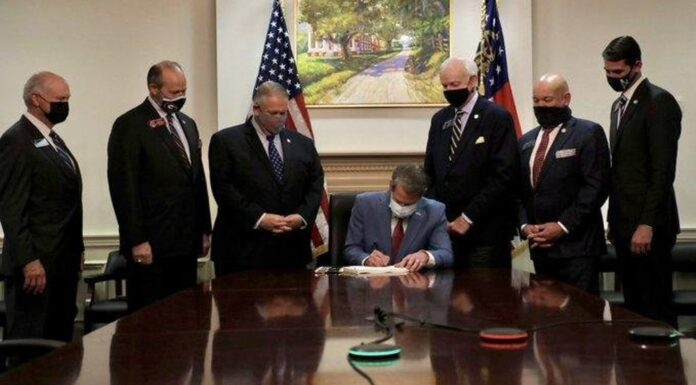 Brian Kemp signs Georgia's SB 202 Election Integrity Act