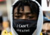 "A protester with an ""I Can't Breathe"" mask"