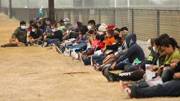 Illegal immigrants wait for Border Patrol