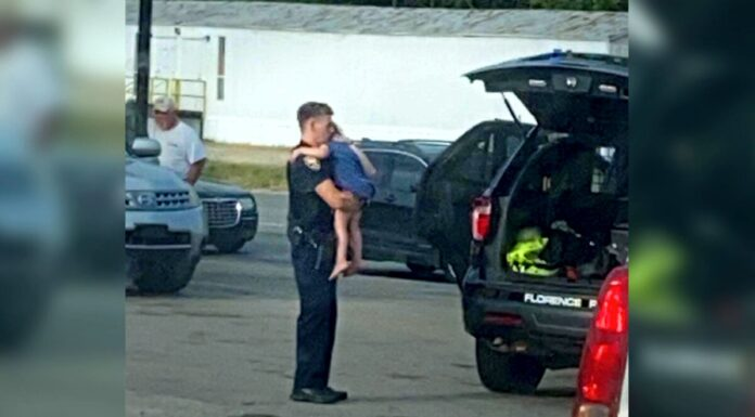 Alabama Police Office Comforting Child