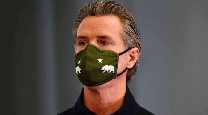 CA Gov. Gavin Newsome in a mask
