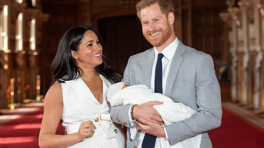 Prince Harry and Meghan Markle and baby Lili.
