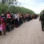 Venezuelans Immigrants waiting to be picked up by Border Patrol
