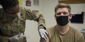 A member of the U.S. Air Force receives the Moderna COVID-19 vaccine