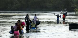 A group of illegal immigrants crosses the Rio Grande from Acuna, Mexico, to Del Rio, Texas