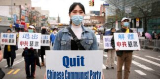 Falun Gong practitioners take part in a parade in Flushing, New York