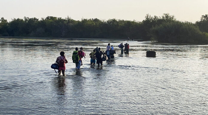 Illegal immigrants cross Rio Grande from Acuna, Mexico, to Del Rio, TX