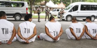Illegal immigrants wait to be magistrated on trespassing