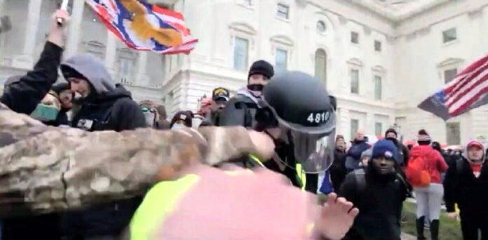 Scott Fairlamb punches a Metropolitan Police