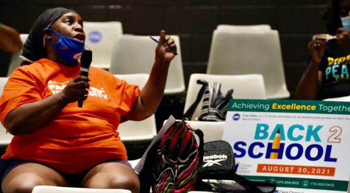 Community member Cynthia Johnson speaks at a Chicago Public Schoo