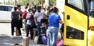 Illegal Immigrants boarding bus in Del Rio Texas