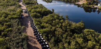 Steel barrier' of hundreds of state trooper SUVs line the border in Texas