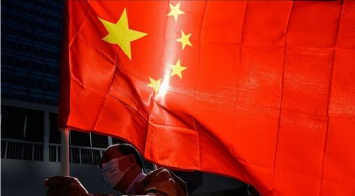 Chinese Man with Chinese Flag